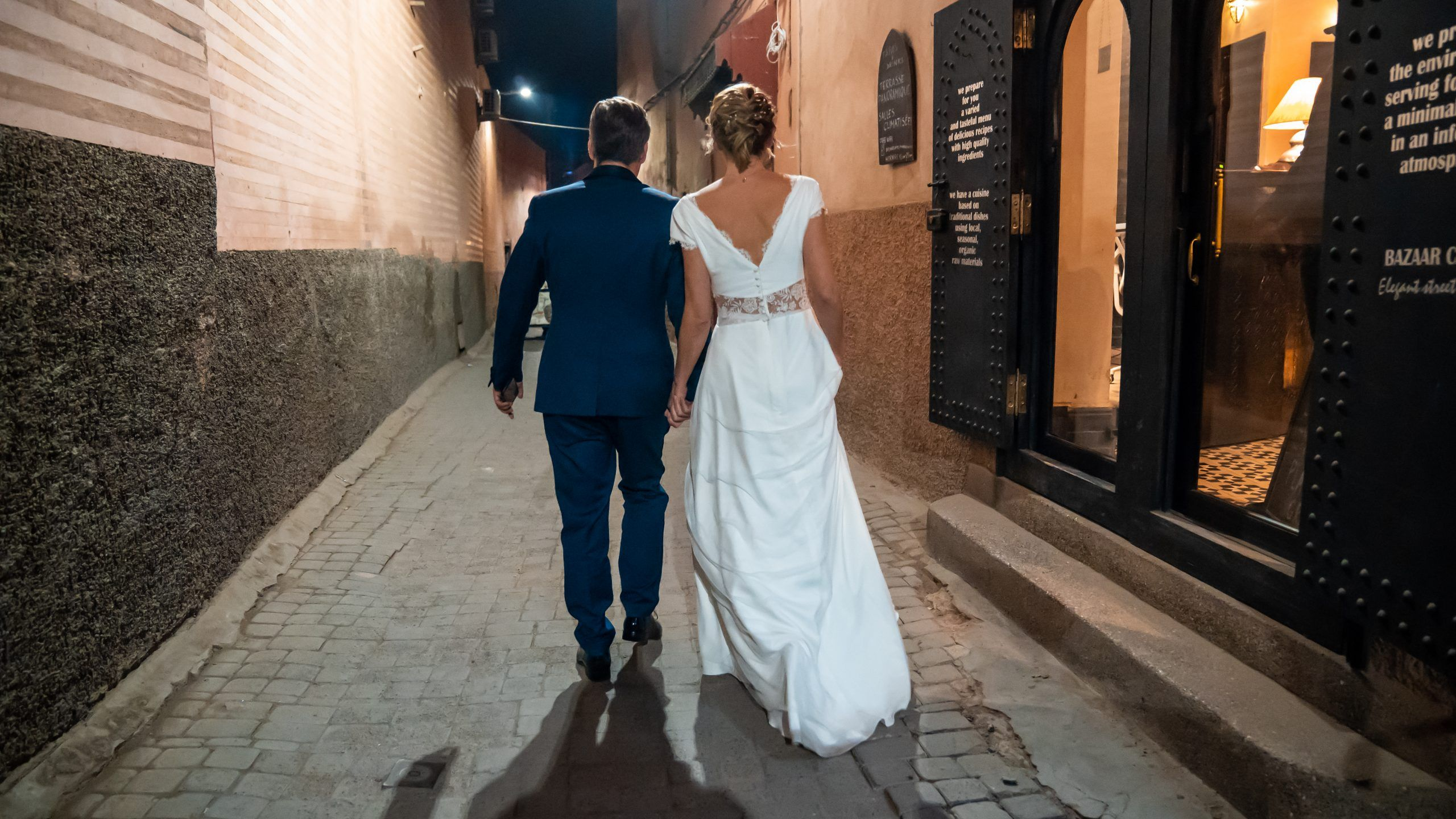 Bride and Groom walking hand in hand to their Simple Chic Wedding